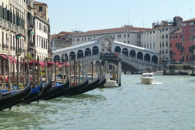 Classic Venetian gondolas and bridge