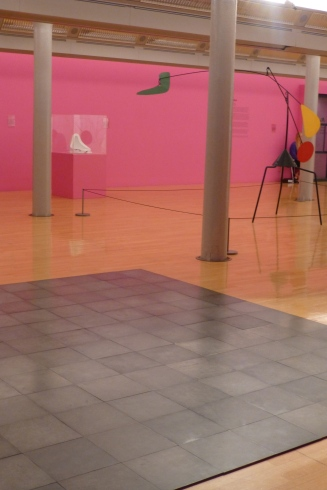 Modern art - a Calder mobile, a Duchamp urinal, and tiles on the floor